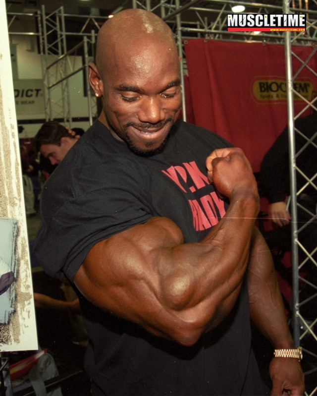 big black muscle men huge bodybuilder wheeler biceps flex guns