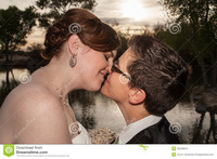free gay pics kissing married gay couple newlywed lesbians outside near pond royalty free stock photo