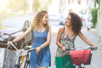 free gay pics william multiracial couple friends riding bikes street they are women wearing summer clothes stock photo gay