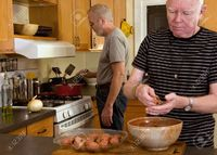 Mature gay men ejwhite mature gay couple cooking dinner stock photo men