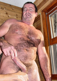 Adonis' big black cock plog hairychest musclebears very furry daddies fuzzy studly manly men hairy musclemen silverdaddies muscular athletic squeezing his balls tight guy huge gay black cock
