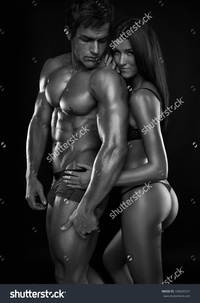 black naked males stock photo half naked sexy couple beautiful woman holding muscular man isolated black background pic