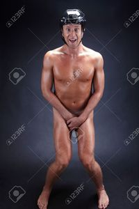 black naked males pressmaster naked man hockey helmet over black background stock photo