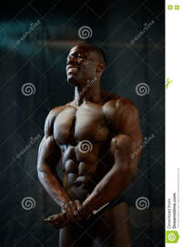 body builder naked portrait smiling african american male bodybuilder naked torso posing black studio background human body perfection stock photo