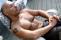 gay hunk men hunky stud man sleeping poolside asleep