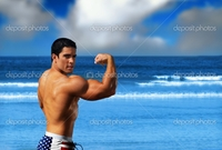 hot male body builders depositphotos bodybuilder beach stock photo