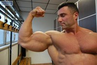 Italian muscle men alessandro grassi flexing biceps italian
