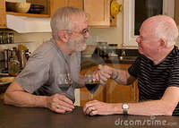 mature gay pic mature gay couple having wine stock