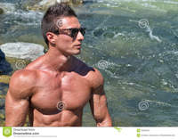 muscled men naked attractive young muscle man naked outdoors water behind him handsome large copy space stock