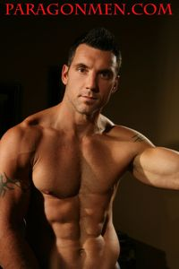 naked muscle mans tattooed muscle hunk strength gets wet naked shows off paragon men mid aka tommy tucker
