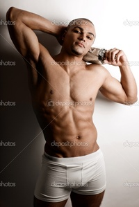 nude bodybuilder depositphotos strong wet sexy nude young bodybuilder posing bottle stock photo