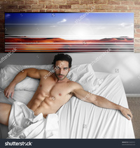 sexy nude male models stock photo sexy nude male model laying back bed home cool loft interior pic